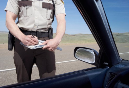 highway patrolman writing ticket